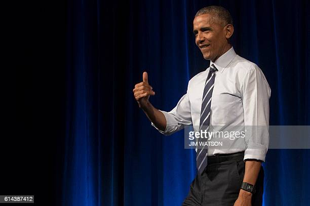 US President Barack Obama gestures after delivering remarks at an event for the Ohio Democratic Party and Governor Ted Strickland in Columbus Ohio...