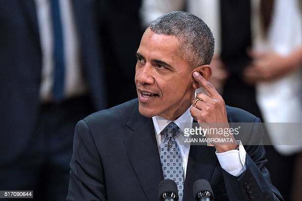"""President Barack Obama gestures as he delivers a speech at the """"Usina del Arte"""" cultural center in Buenos Aires on March 23, 2016. The United States..."""