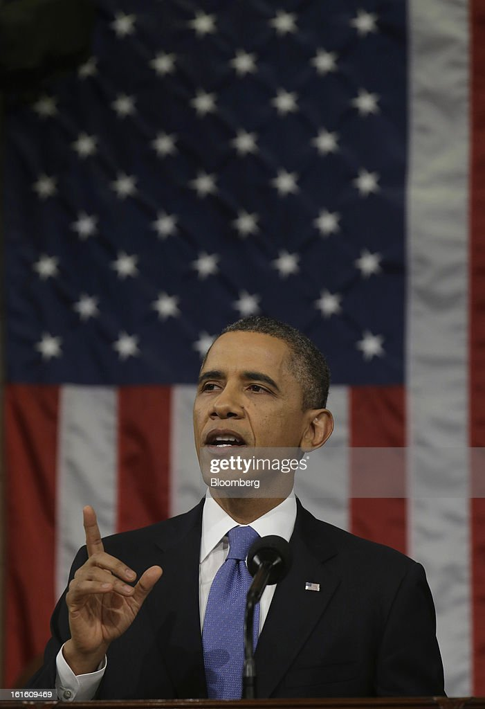 U.S. President Barack Obama gestures as he delivers the State of the Union address to a joint session of Congress at the Capitol in Washington, D.C., U.S., on Tuesday, Feb. 12, 2013. Obama called for raising the federal minimum wage to $9 an hour and warned he'll use executive powers to get his way on issues from climate change to manufacturing if Congress doesn't act, laying out an assertive second-term agenda sure to provoke Republicans. Photographer: Charles Dharapak/Pool via Bloomberg