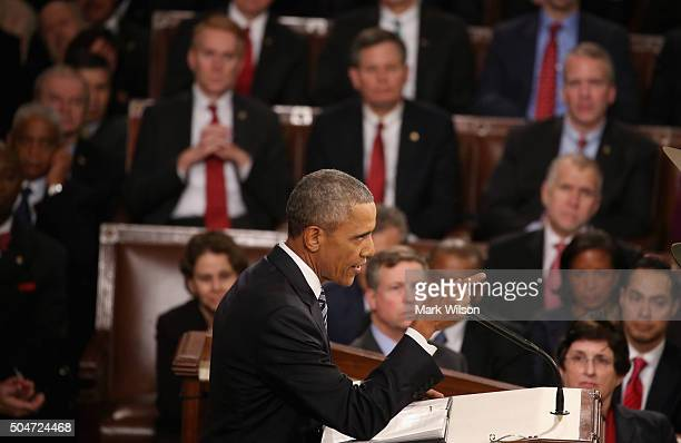 S President Barack Obama gestures as he delivers the State of the Union speech before members of Congress in the House chamber of the US Capitol...