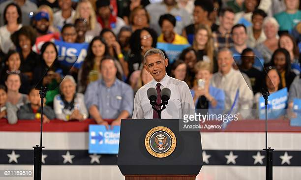 S President Barack Obama gestures as he is giving a speech during a presidential election campaign rally supporting Democrat Party's Presidential...