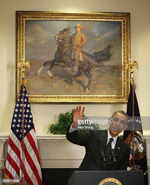 S President Barack Obama gestures as he speaks during a Medal of Honor ceremony for Army First Lieutenant Alonzo H Cushing in the Roosevelt Room of...