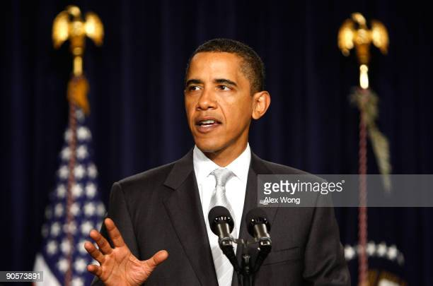 President Barack Obama gestures as he speaks on health insurance reform at the Eisenhower Executive Office Building of the White House on September...