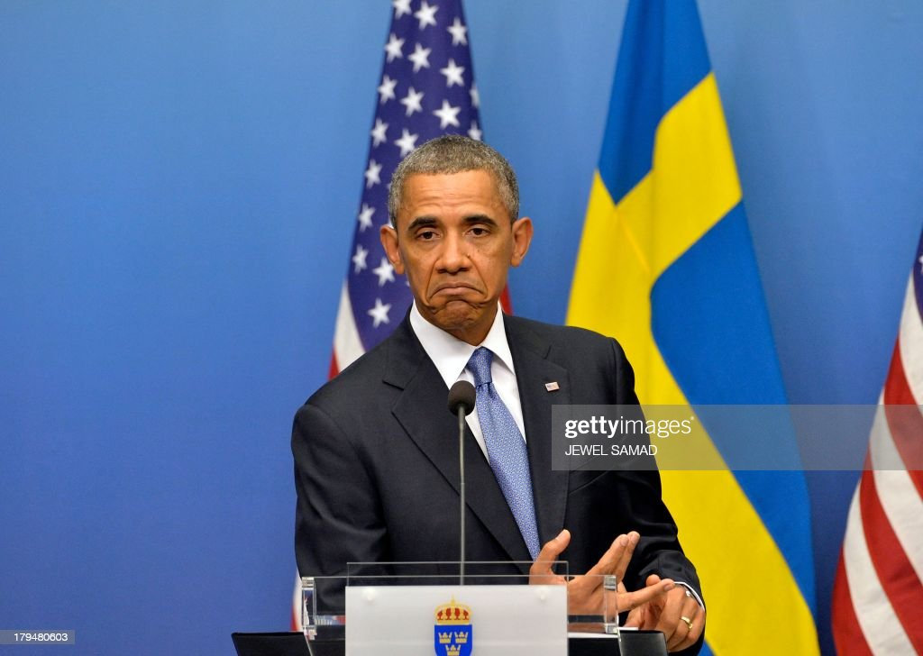US President Barack Obama gestures during a joint press conference with Swedish Prime Minister after their bilateral meeting at the Rosenbad Building in Stockholm on September 4, 2013. Obama met with Fredrik Reinfeldt upon arrival in Sweden on a two-day official trip before leaving for Russia, where he will attend G20 summit. Russia on Thursday hosts the G20 summit hoping to push forward an agenda to stimulate growth but with world leaders distracted by divisions on the prospect of US-led military action in Syria.
