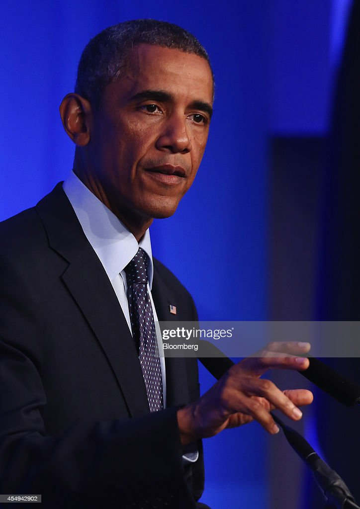U.S. President Barack Obama gestures during a news conference following the North Atlantic Treaty Organization (NATO) summit in Newport, U.K., on Friday, Sept. 5, 2014. Obama said world leaders will move to impose new economic sanctions against Russia even as Ukrainian President Petro Poroshenko and the country's pro-Russian separatists agreed on a cease-fire. Photographer: Chris Ratcliffe/Bloomberg via Getty Images