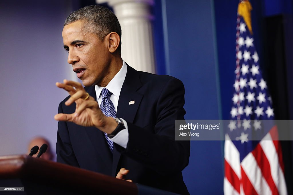 U.S. President Barack Obama gestures during his speech to members of the media during his last news conference of the year in the James Brady Press Briefing Room of the White House December 19, 2014 in Washington, DC. President Obama faced questions on various topics including the U.S. economy and the Sony hack.