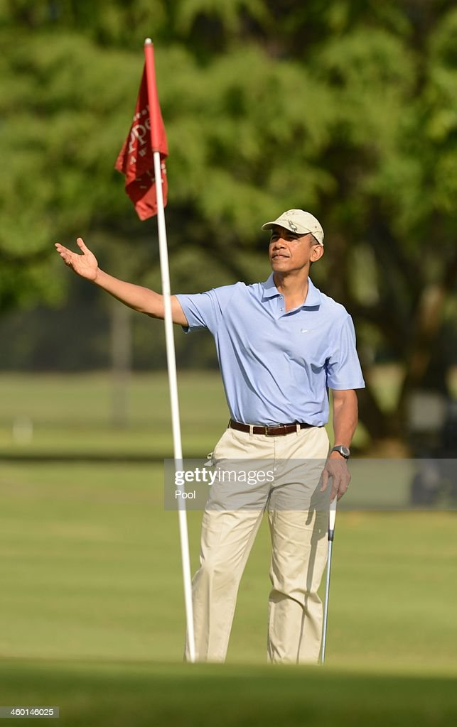 U.S. President Barack Obama gestures on the second green at Marine Corps Base Hawaii's Kaneohe Klipper Golf Course January 2, 2014 in Kaneohe, Hawaii. The Obama family is in Hawaii for the winter holidays.