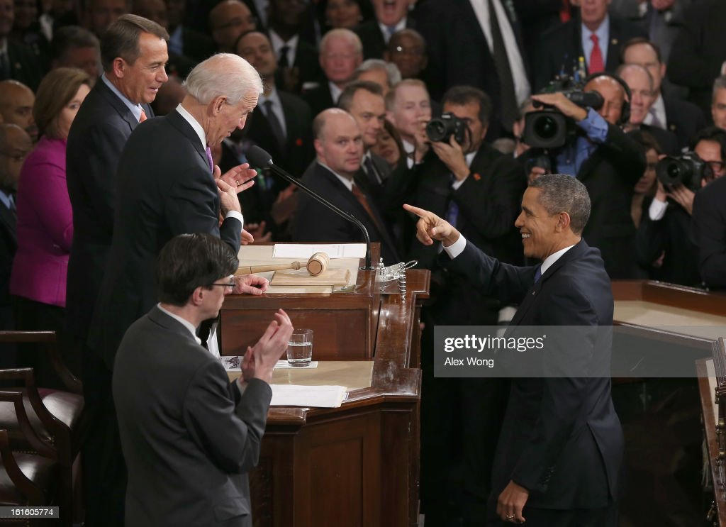 U.S. President Barack Obama (R) gestures to U.S. Vice President Joe Biden (L) and Speaker of the House John Boehner (R) before delivering his State of the Union speech before a joint session of Congress at the U.S. Capitol February 12, 2013 in Washington, DC. Facing a divided Congress, Obama focused his speech on new initiatives designed to stimulate the U.S. economy and said, 'It's not a bigger government we need, but a smarter government that sets priorities and invests in broad-based growth'.