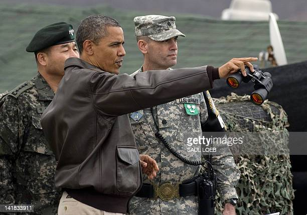 US President Barack Obama gestures towards North Korea from Observation Post Ouellette during a visit to the Joint Security Area of the Demilitarized...