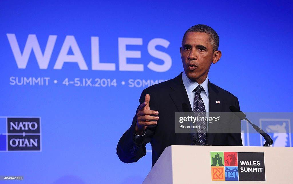 U.S. President Barack Obama gestures while he speaks during a news conference following the North Atlantic Treaty Organization (NATO) summit in Newport, U.K., on Friday, Sept. 5, 2014. Obama said world leaders will move to impose new economic sanctions against Russia even as Ukrainian President Petro Poroshenko and the country's pro-Russian separatists agreed on a cease-fire. Photographer: Chris Ratcliffe/Bloomberg via Getty Images