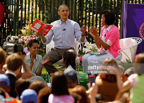 "President Barack Obama gets a round of applause after reading ""Green Eggs and Ham,"" by Dr. Suess, for a group of children and his family, first lady..."