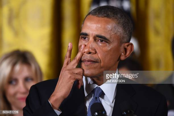 US President Barack Obama gets emotional as he delivers a statement on executive actions to reduce gun violence on January 5 2016 at the White House...