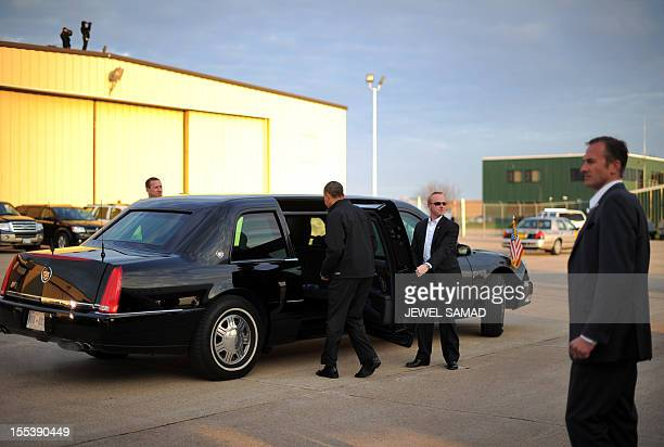 US President Barack Obama gets in his limo upon arriving at the Dubuque Regional Airport in Dubuque Iowa on November 3 2012 Obama and Republican foe...