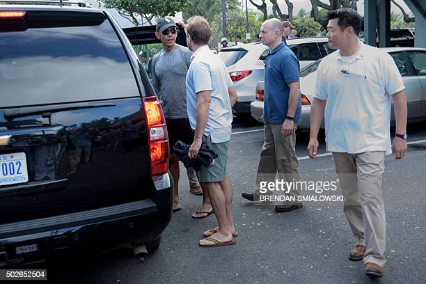 US President Barack Obama gets into his armored car after a stop at Island Snow for shaved ice while on the way home from the beach December 27 2015...