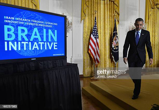 US President Barack Obama gets off the stage after announcing his Administration's BRAIN Brain Research through Advancing Innovative...