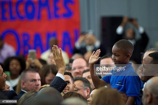 President Barack Obama gives a high five to a boy after delivering a speech at the Salvation Army Ray Joan Kroc Corps Community Center May 18 2015 in...