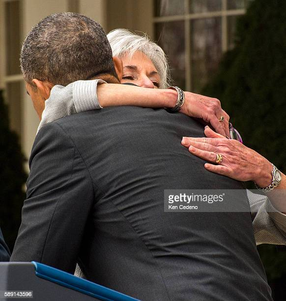 US President Barack Obama gives a hug to outgoing Health and Human Services Secretary Kathleen Sebelius following remarks in the Rose Garden of the...