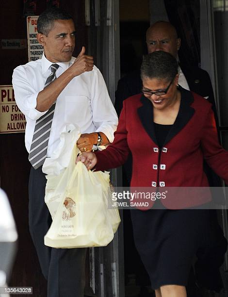 US President Barack Obama gives a thumbs up as he walks out of the Roscoe's Chicken and Waffles in Los Angeles California on October 24 2011 Obama...