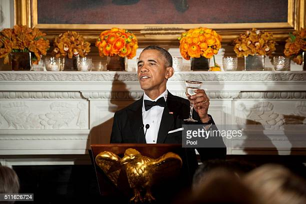 President Barack Obama gives a toast during a National Governors Association dinner and reception in the State Dining Room of the White House...