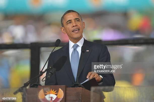 US President Barack Obama gives an address during South African former president Nelson Mandela's memorial service at the FNB Stadium in Johannesburg...