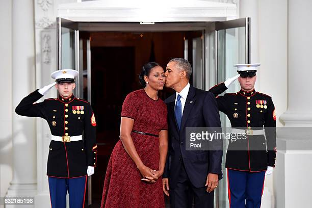 President Barack Obama gives Michelle Obama a kiss as they wait for Presidentelect Donald Trump and wife Melania at the White House before the...