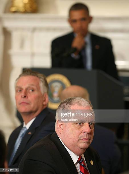 President Barack Obama , Gov. Terry McAuliffe , and Gov. Larry Hogan , listen to questions during a meeting with members of the National Governors...