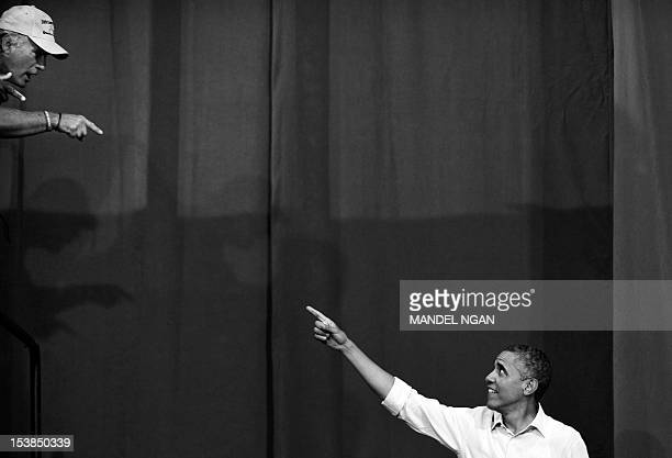 President Barack Obama greets a supporter as he arrives to speak at a campaign event July 13 2012 at Phoebus High School in Hampton Virginia AFP...