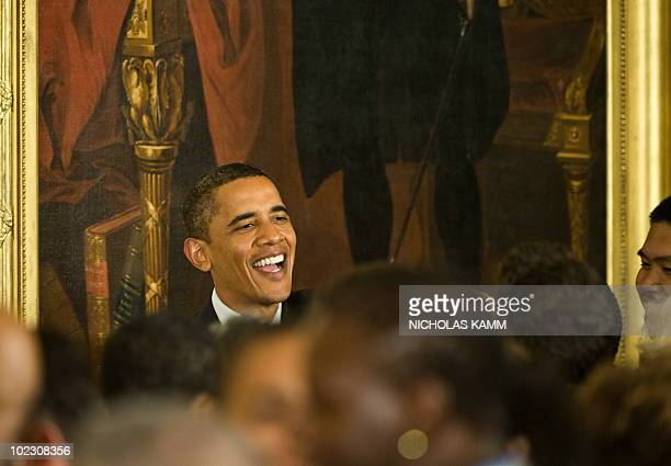 US President Barack Obama greets attendees after speaking at a Lesbian Gay Bisexual and Transgender Pride Month event in the East Room of the White...