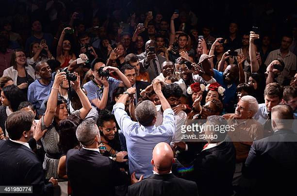 US President Barack Obama greets attendees after speaking on the economy at the Paramount Theatre in Austin Texas on July 10 2014 Obama hailed new...