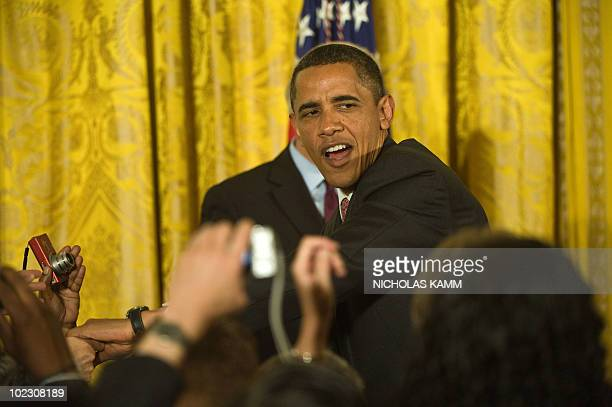 US President Barack Obama greets attendees before speaking at a Lesbian Gay Bisexual and Transgender Pride Month event in the East Room of the White...