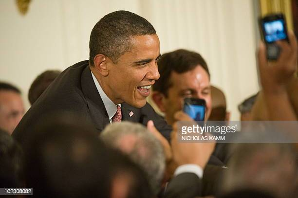 US President Barack Obama greets attendees before speaking at an Lesbian Gay Bisexual and Transgender Pride Month event in the East Room of the White...