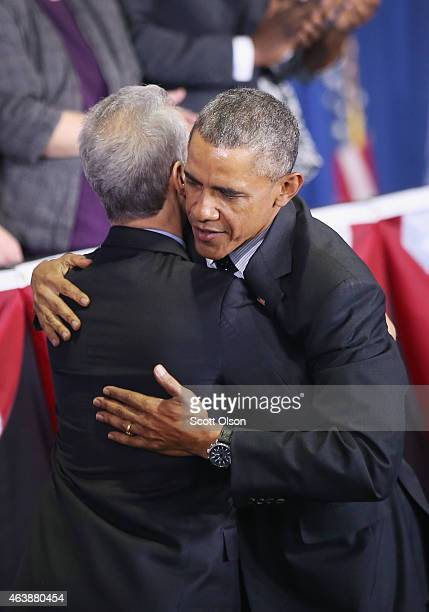 President Barack Obama greets Chicago Mayor Rahm Emanuel before delivering a speech at the Gwendolyn Brooks College Preparatory Academy on February...