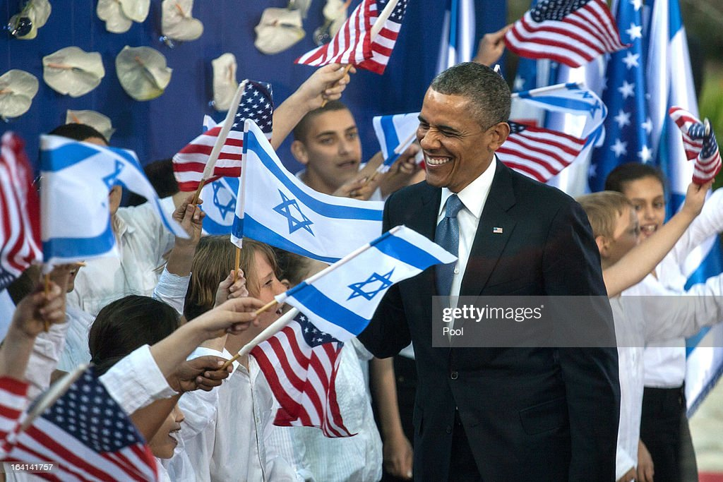 U.S. President Barack Obama (L) greets children as he is escorted by Israeli President Shimon Peres following a welcome ceremony at the President's residence on March 20, 2013 in Jerusalem, Israel. This will be Obama's first visit as president to the region, and his itinerary will include meetings with the Palestinian and Israeli leaders as well as a visit to the Church of the Nativity in Bethlehem.