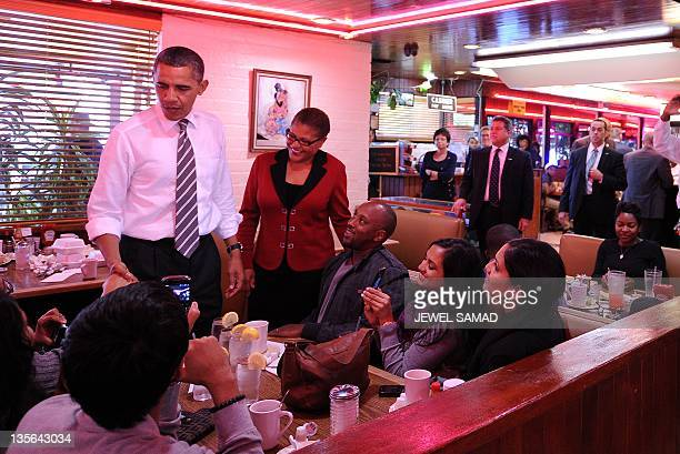 US President Barack Obama greets dinners after placing his order at the Roscoe's Chicken and Waffles in Los Angeles California on October 24 2011...