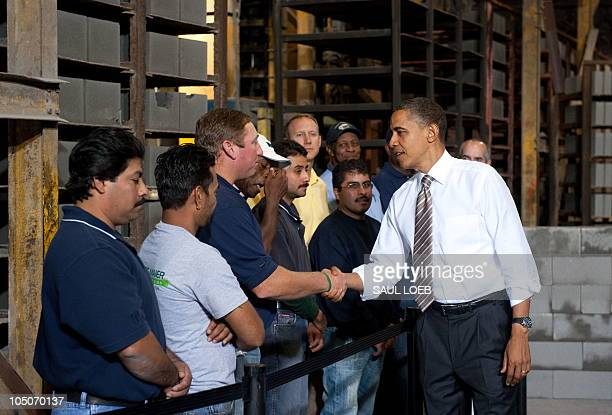 US President Barack Obama greets employees after speaking on the monthly jobs numbers at Ernest Maier Block in Bladensburg Maryland October 8 2010...
