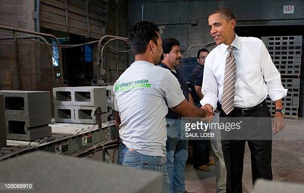 US President Barack Obama greets employees while touring Ernest Maier Block in Bladensburg Maryland October 8 prior to speaking on the monthly jobs...