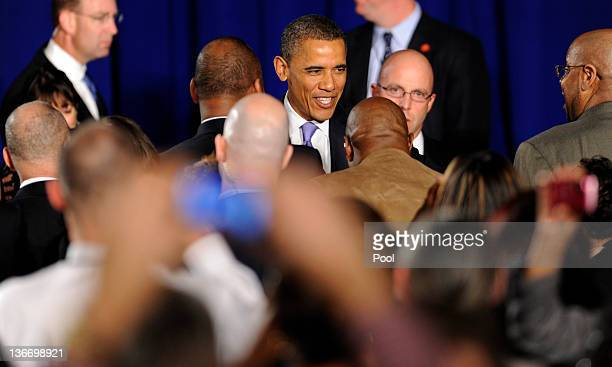 President Barack Obama greets Environmental Protection Agency employees after speaking January 10, 2012 in Washington, DC. In Obama's first visit to...