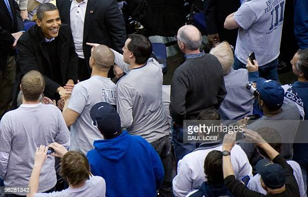 US President Barack Obama greets fans during the second half of the NCAA men's college basketball game between Georgetown and Duke at the Verizon...