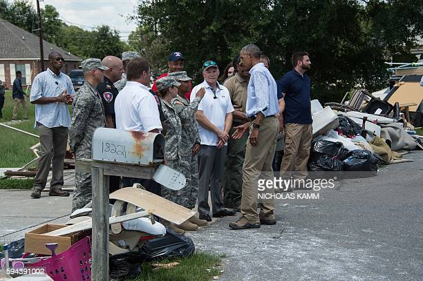 President Barack Obama greets first responders as he tours a flood-affected area in Baton Rouge, Louisiana, on August 23, 2016. Fresh from a two-week...