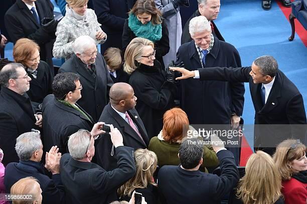 President Barack Obama greets Former President Bill Clinton Secretary of State Hillary Rodham Clinton Former President Jimmy Carter and Former First...