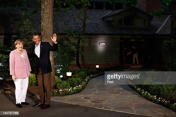 S President Barack Obama greets German Chancellor Angela Merkel in front of Laurel Lodge at Camp David during the 2012 G8 Summit on Friday May 18...