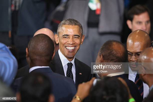 President Barack Obama greets guests after delivering a speech at the Gwendolyn Brooks College Preparatory Academy on February 19 2015 in Chicago...