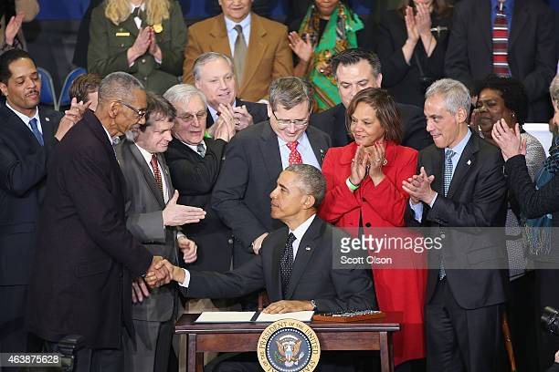 President Barack Obama greets guests after signing a proclamation at the Gwendolyn Brooks College Preparatory Academy on February 19 2015 in Chicago...