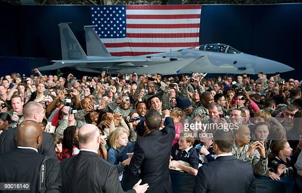 President Barack Obama greets guests during a rally with US troops and their families at Elmendorf Air Force Base in Anchorage, Alaska, November 12,...