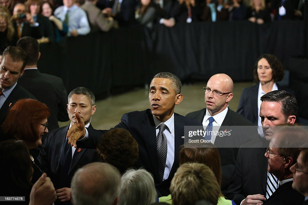 President Barack Obama greets guests following a speech at Argonne National Laboratory on March 15, 2013 in Argonne, Illinois. Obama used the event to push for more federally funded research into clean energy technologies. Argonne is the current home of a $120 million federal project to develop smaller, cheaper and more powerful batteries for electric vehicles.