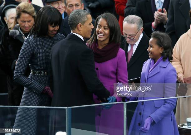 S President Barack Obama greets his family First lady Michelle Obama and daughters Malia Obama and Sasha Obama after being sworn in during the public...