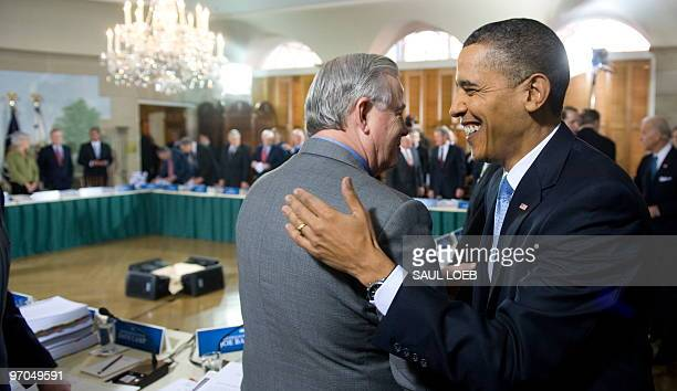 US President Barack Obama greets House Energy and Commerce Committee Ranking Member Joe Barton prior to hosting a bipartisan meeting with members of...