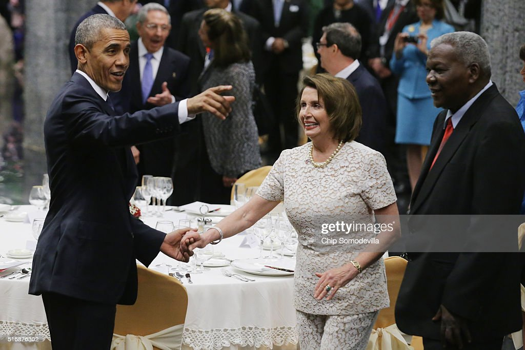 U.S. President Barack Obama (L) greets House Minority Leader Nancy Pelosi (D-CA) (C) while acknowledging members of Congress that are attending a state dinner at the Palace of the Revolution March 21, 2016 in Havana, Cuba. March 21, 2016 in Havana, Cuba. This is the first time a sitting U.S. president has visited Cuba in 88 years.