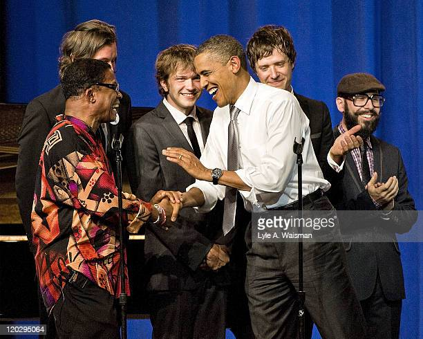 President Barack Obama greets jazz musician Herbie Hancock and members of the band OK Go during a fundraiser at the Aragon Ballroom on August 3, 2011...