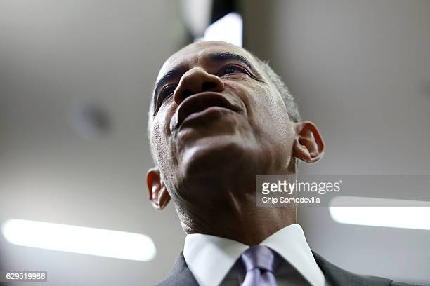 President Barack Obama greets lawmakers after signing the 21st Century Cures Act into law at the Eisenhower Executive Office Building December 13,...